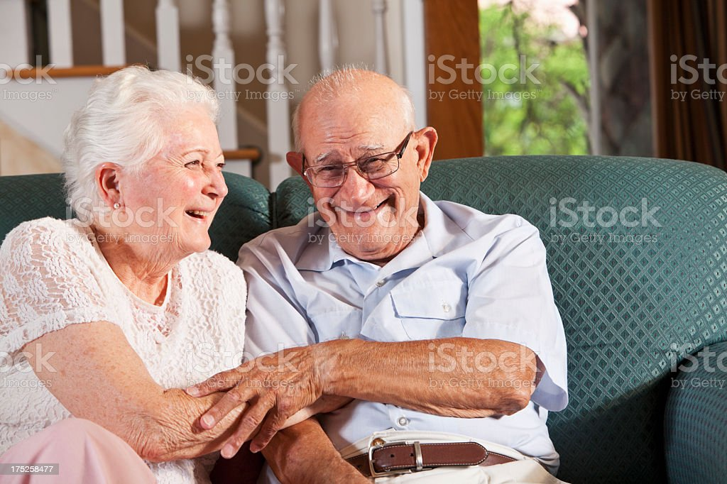 Senior couple at home laughing royalty-free stock photo