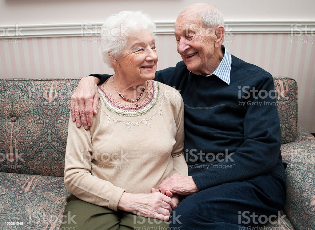 Senior couple at home sharing a happy moment royalty-free stock photo