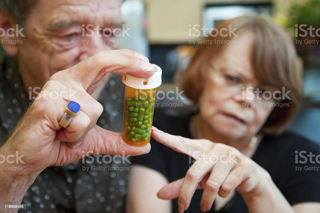Senior Couple at Home with Prescription royalty-free stock photo