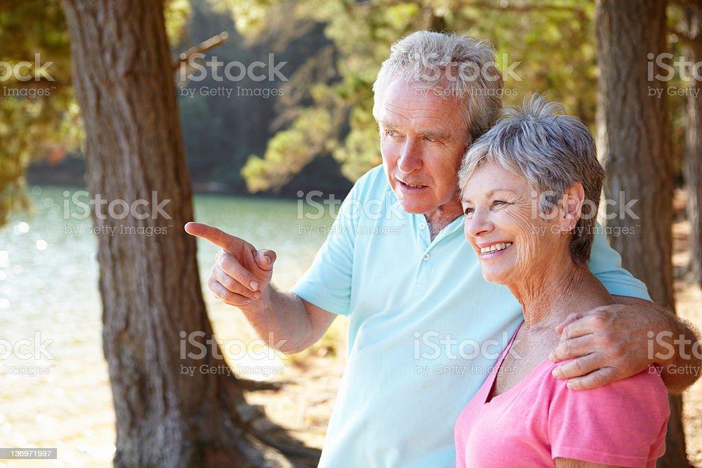 Senior couple at lake together royalty-free stock photo