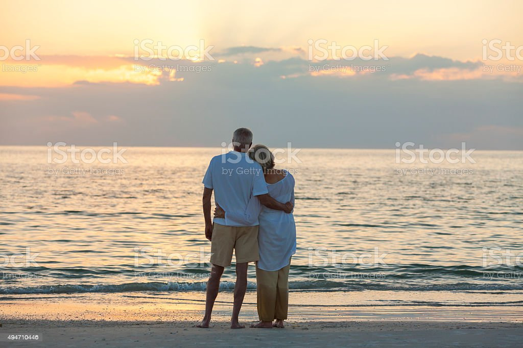 Senior Couple at Sunset Tropical Beach stock photo