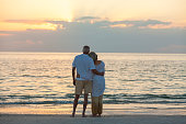 Senior Couple at Sunset Tropical Beach