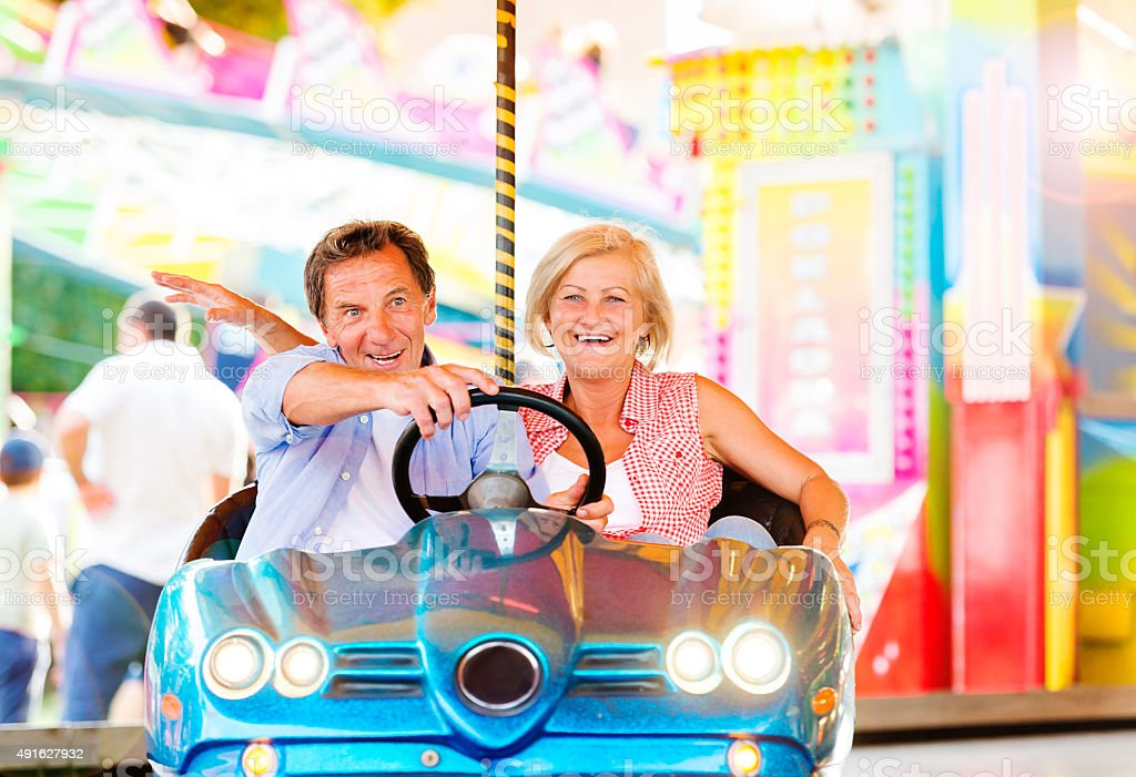 Senior couple at the fun fair stock photo