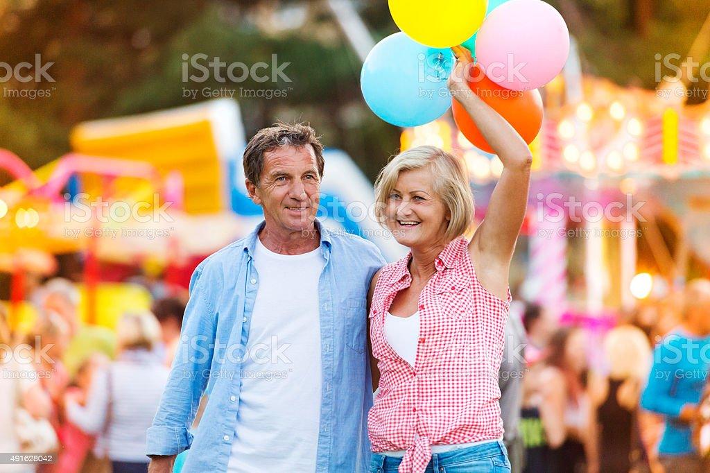 Senior couple at the fun fair stock photo