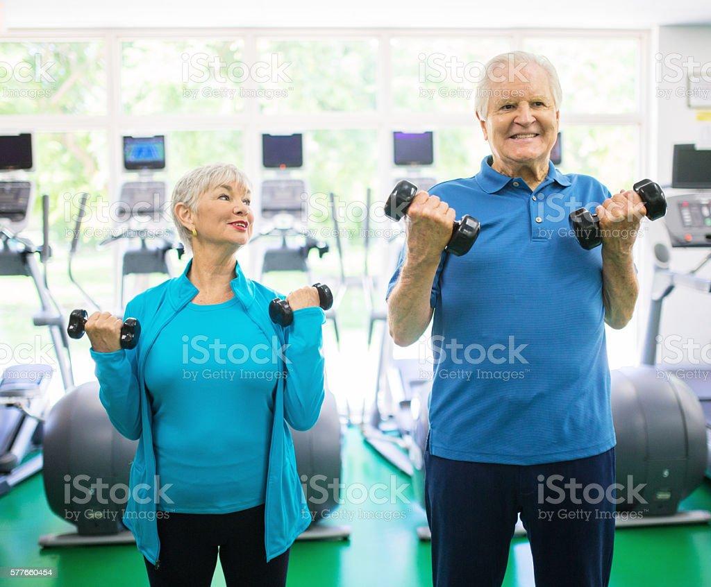 Senior couple at the gym stock photo