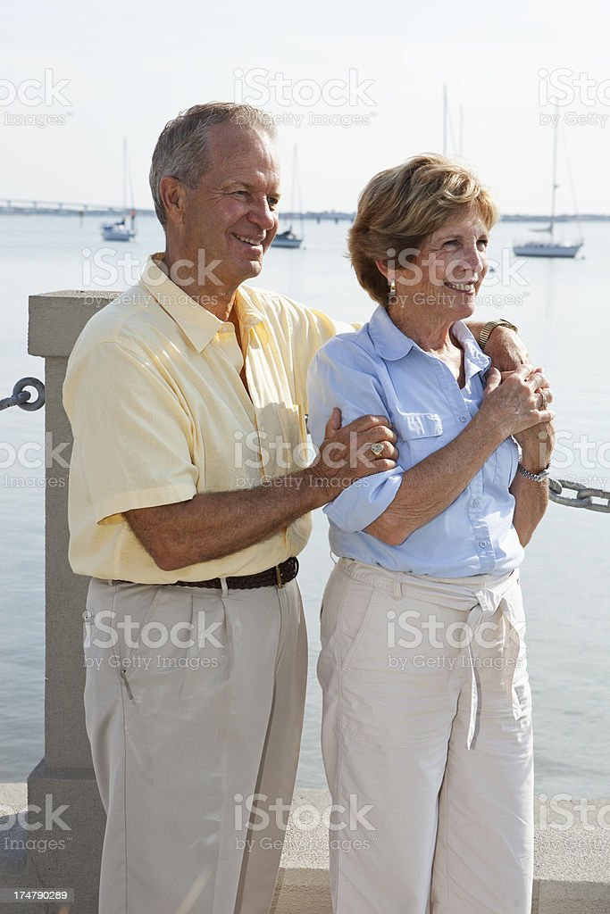 Senior couple at waterfront stock photo