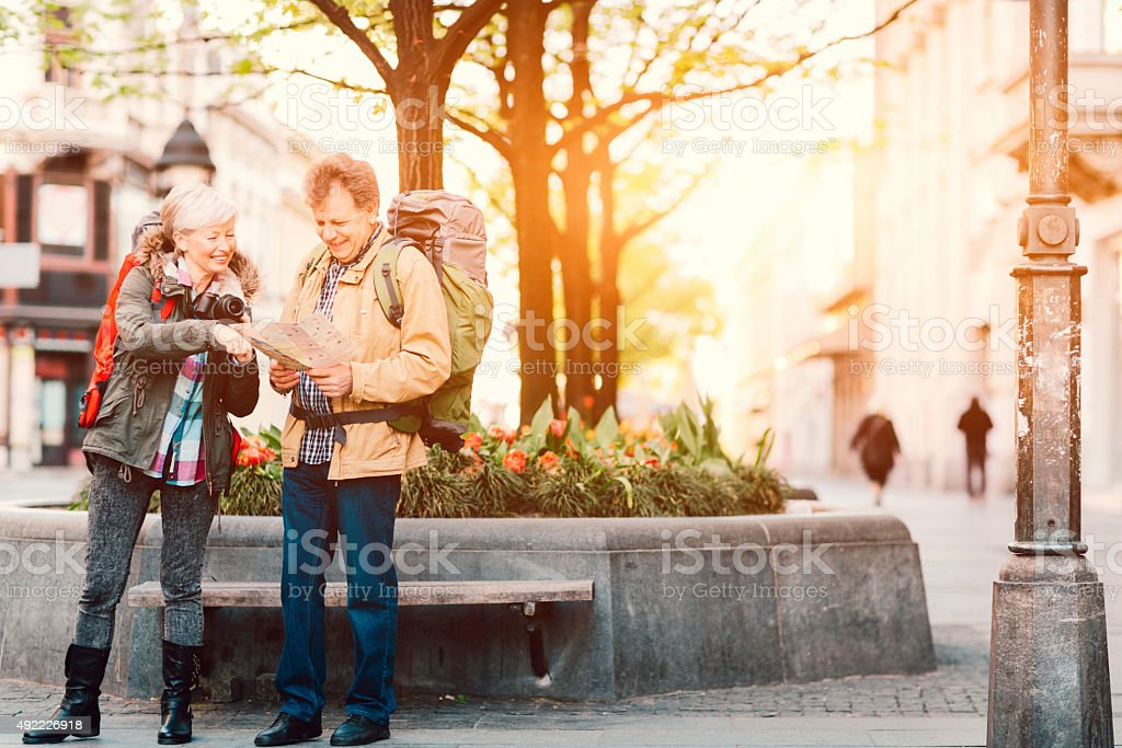 Senior Couple Backpackers in the city. stock photo