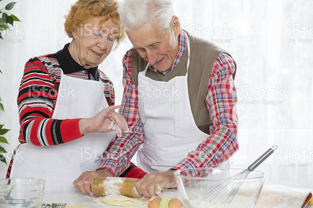 Senior couple baking royalty-free stock photo