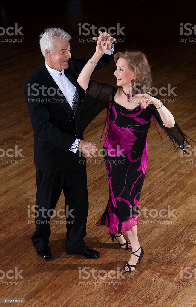 Senior couple ballroom dancing stock photo