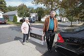 Senior couple bringing home new flat screen television