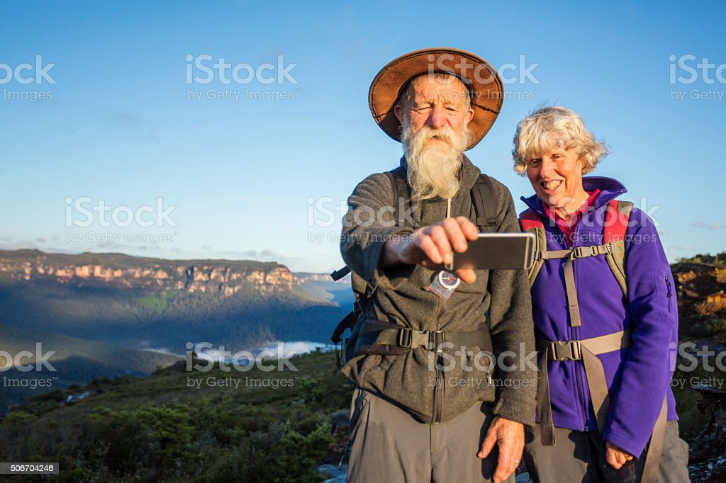 Senior Couple Bushwalker Selfie in Spectacular Landscape stock photo