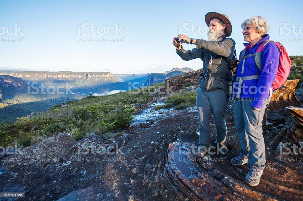 Senior Couple Bushwalker Selfie in Spectacular Landscape stock photo