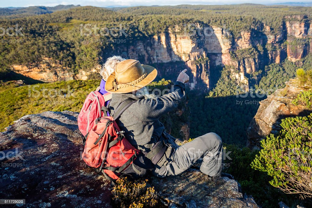 Senior Couple Bushwalkers Enjoying Spectacular Landscape Views stock photo
