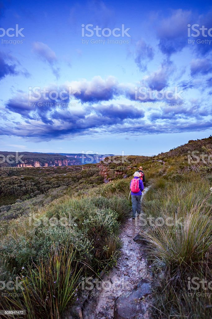 Senior Couple Bushwalking at Dawn in a Spectacular Landscape stock photo