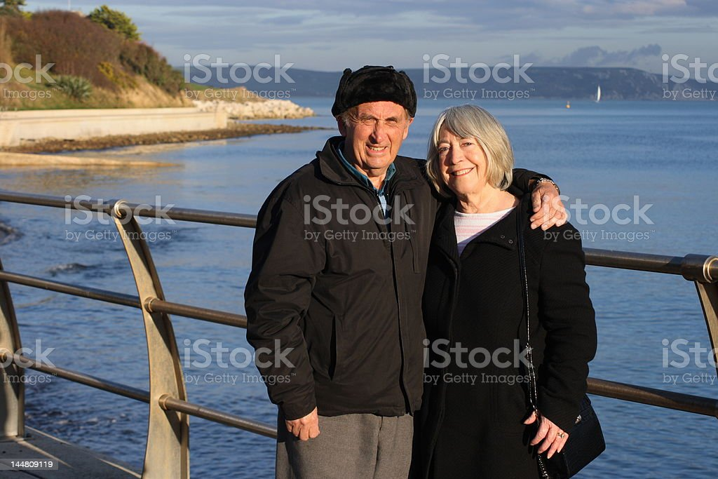 Senior couple by the sea royalty-free stock photo