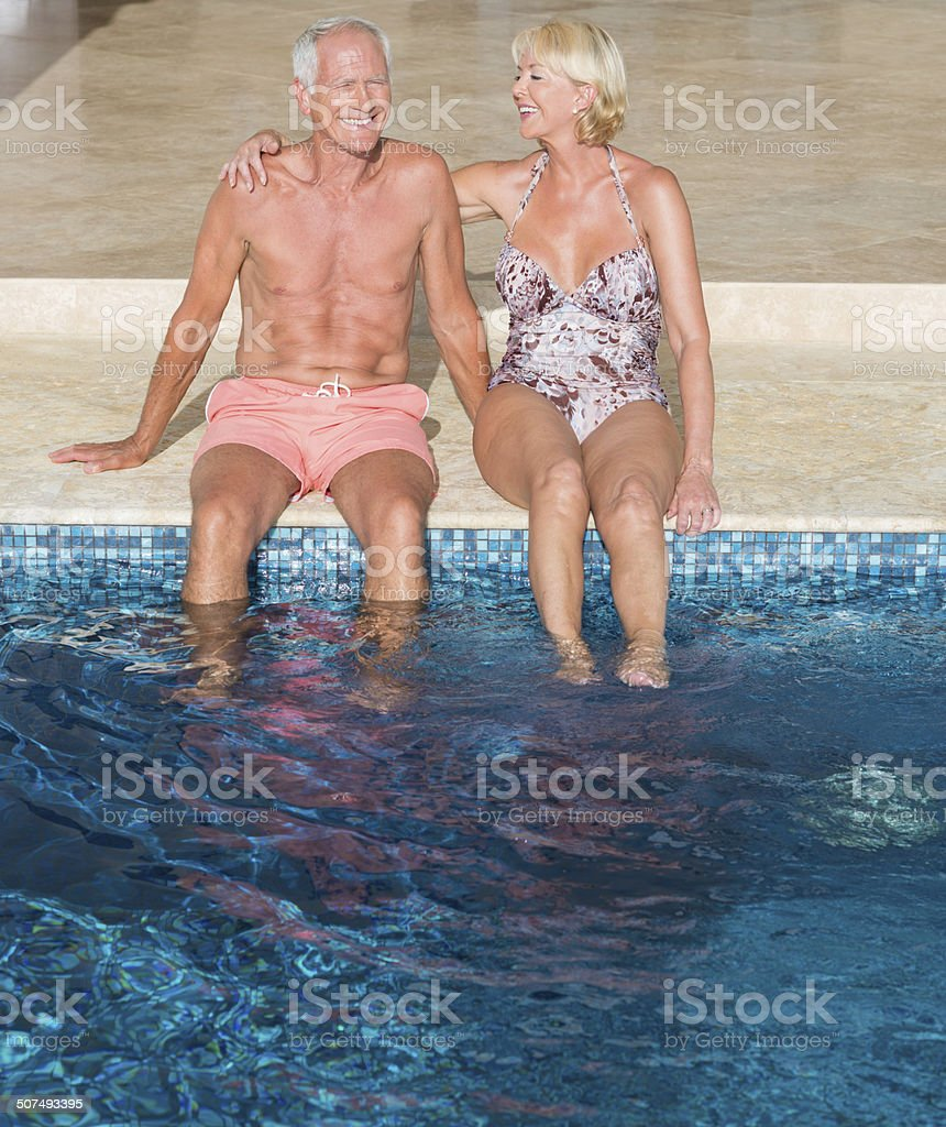 Senior Couple By The Swimming Pool royalty-free stock photo