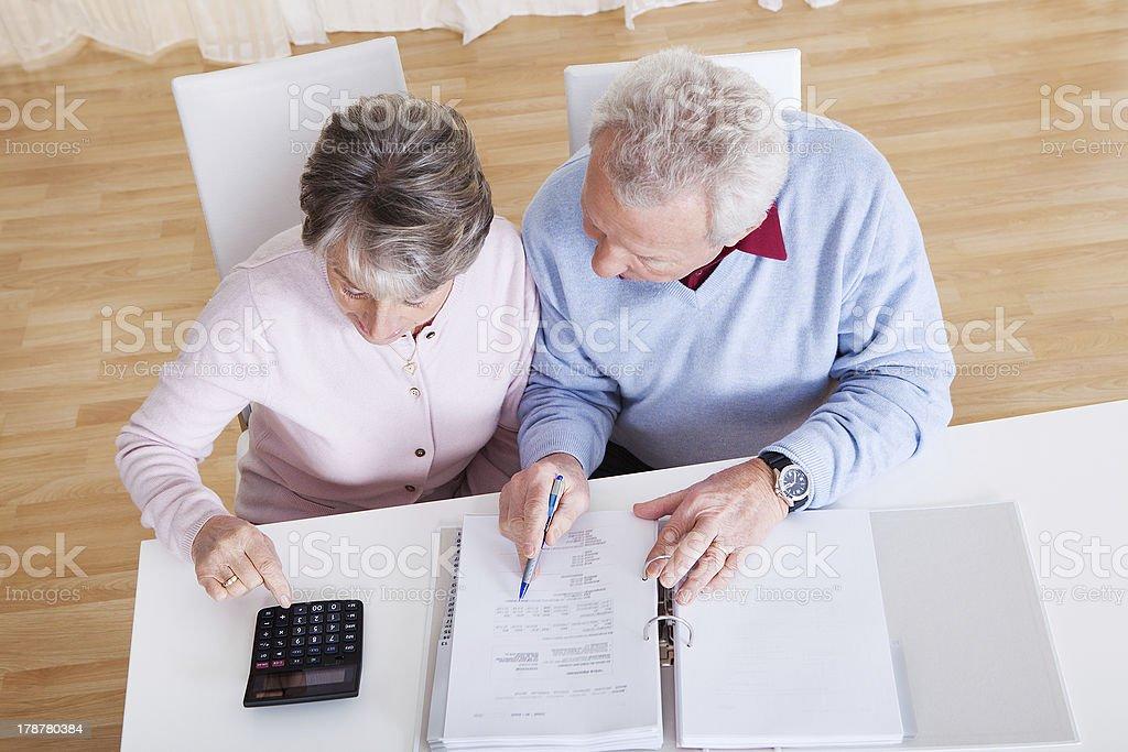 Senior Couple Calculating Budget stock photo