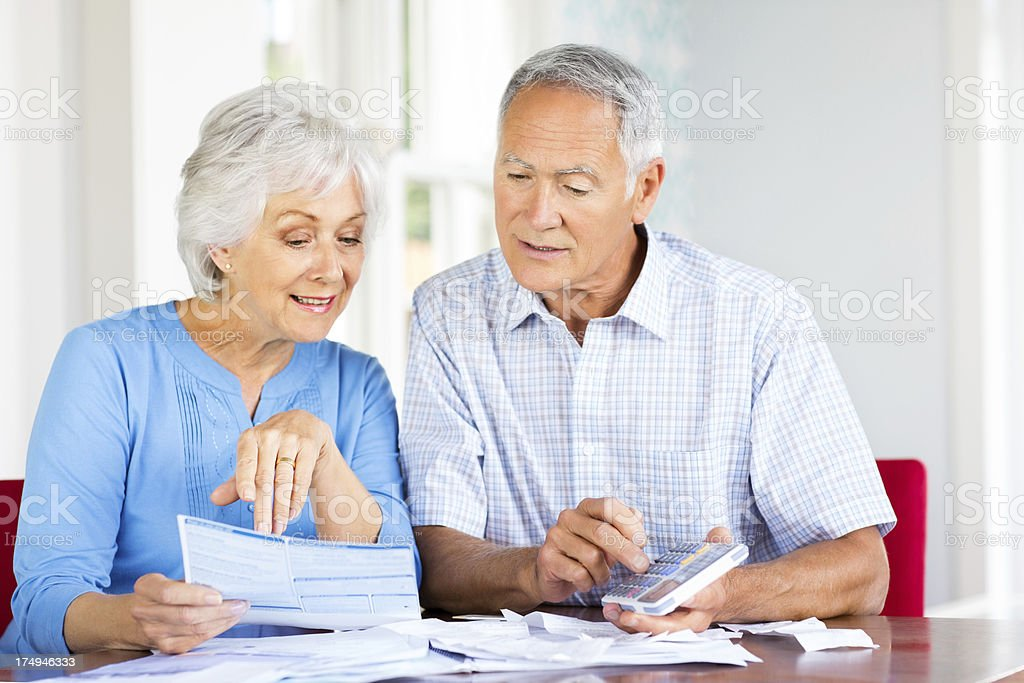 Senior Couple Calculating Domestic Bills. royalty-free stock photo
