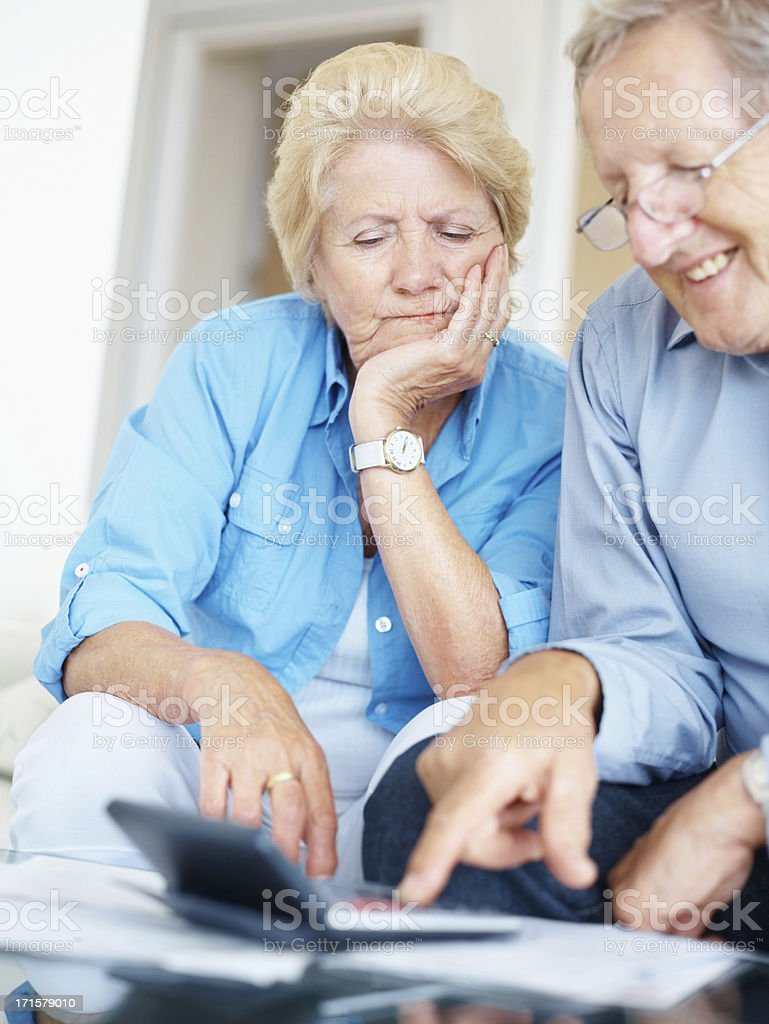 Senior couple calculating their accounts at home royalty-free stock photo