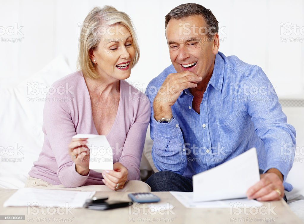 Senior couple calculating their personal finances at home royalty-free stock photo