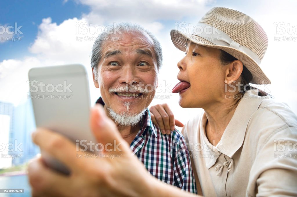 Senior couple candid moments together having a vacation stock photo