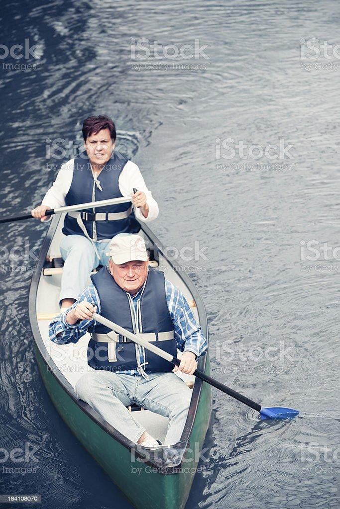 Senior couple canoeing royalty-free stock photo