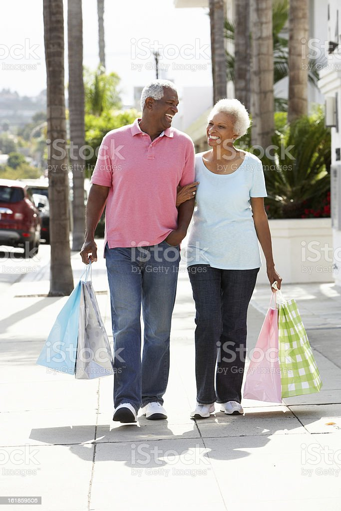 Senior Couple Carrying Shopping Bags royalty-free stock photo
