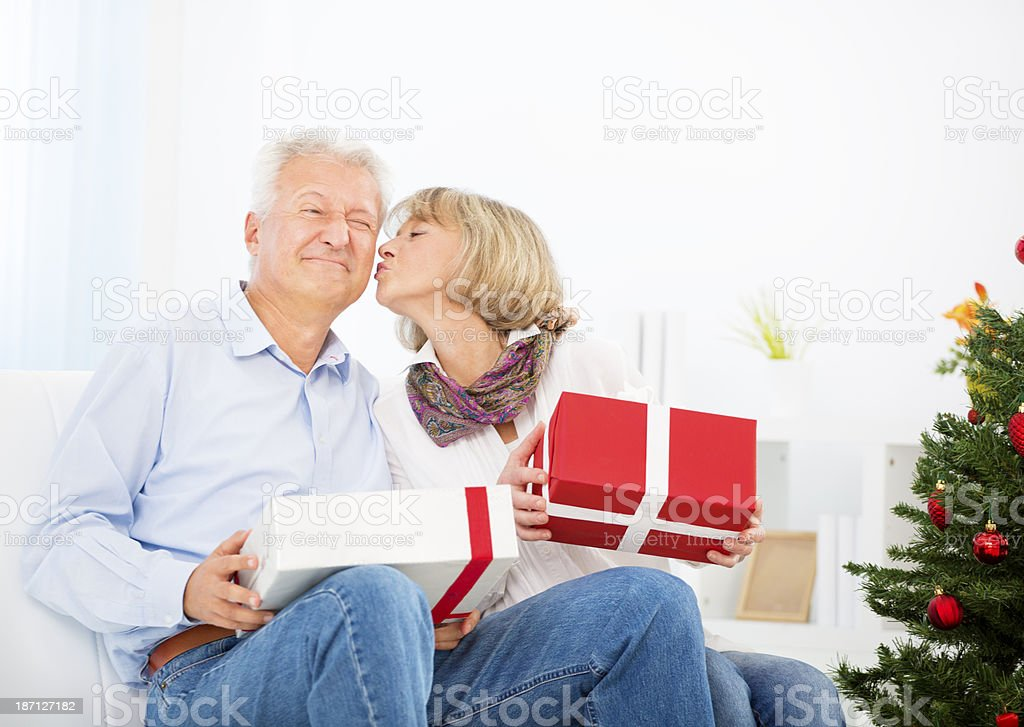 Senior couple celebrating Christmas. royalty-free stock photo