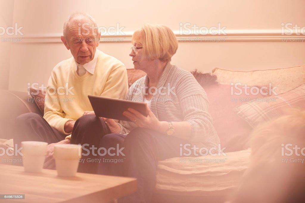 Senior couple checking insurance policy stock photo