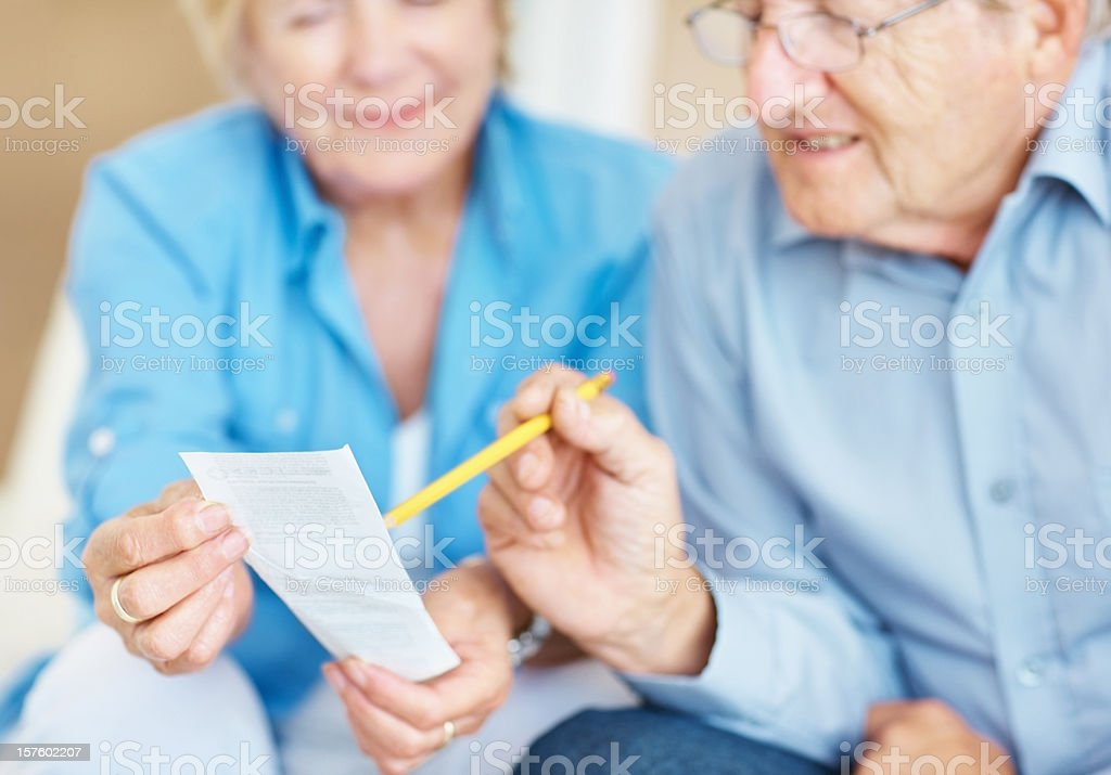 Senior couple checking their accounts at home royalty-free stock photo