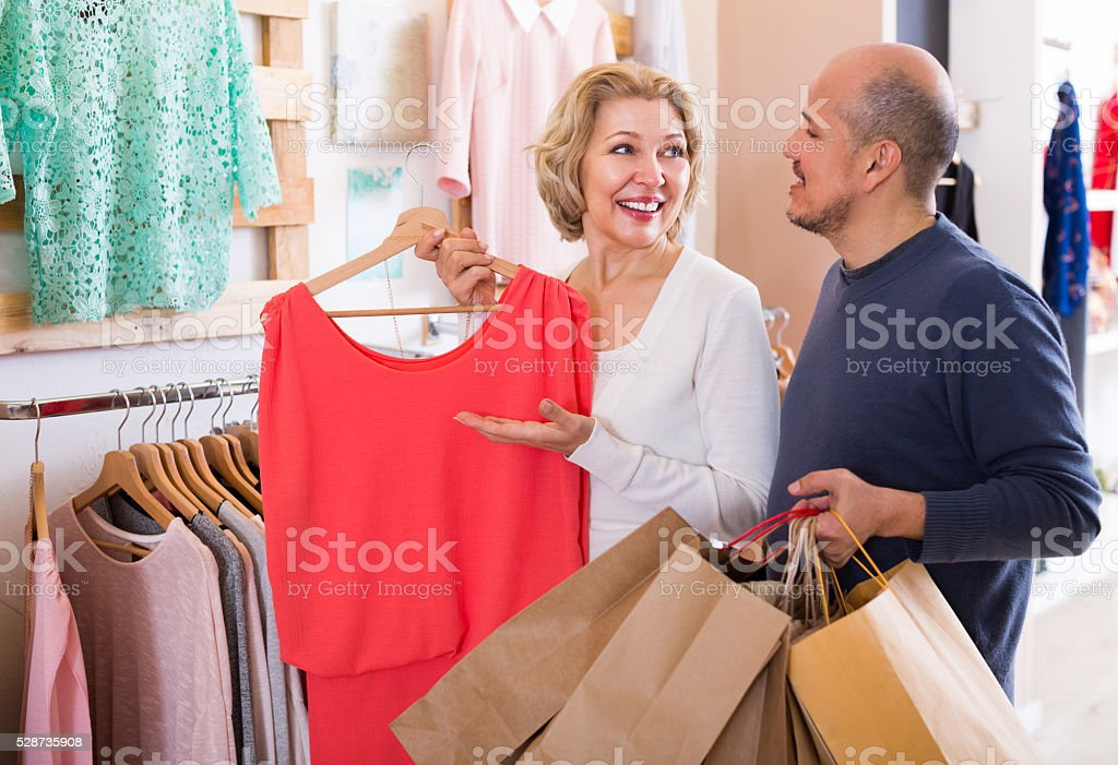 Senior couple choosing new fancy dress stock photo