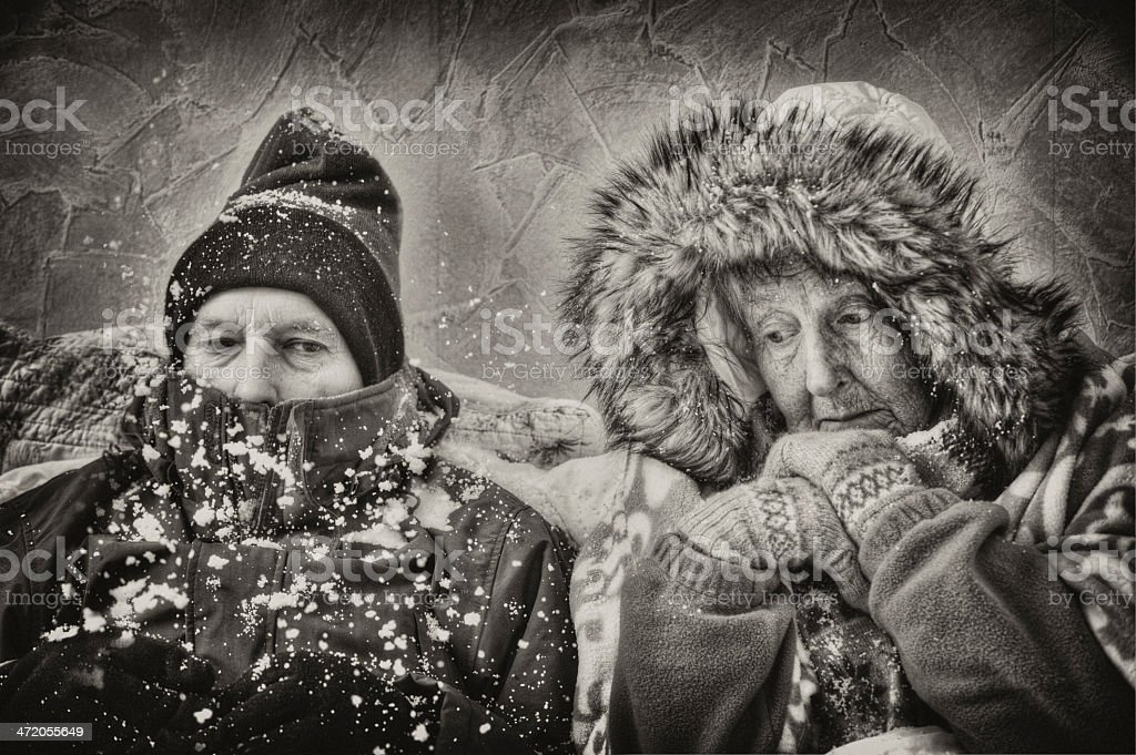 Senior couple, cold and miserable royalty-free stock photo