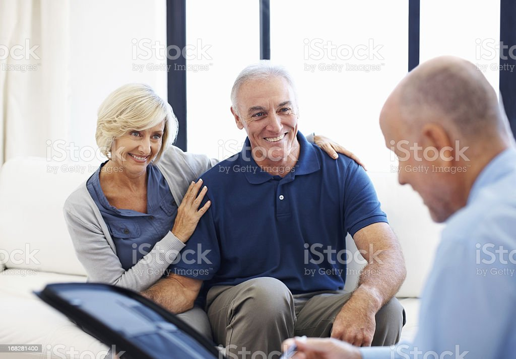 Senior couple consulting with financial advisor royalty-free stock photo