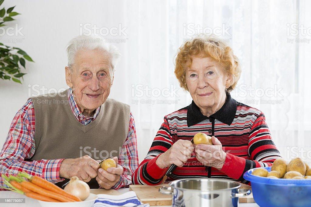 Senior couple cooking royalty-free stock photo