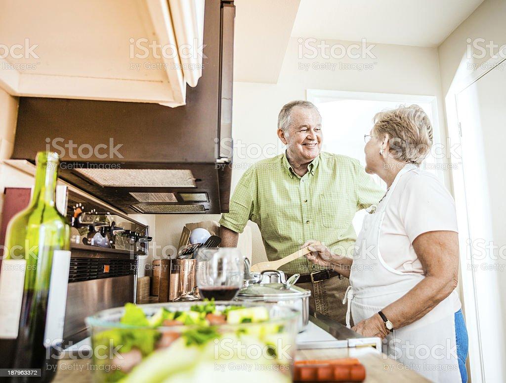 Senior couple cooking stock photo