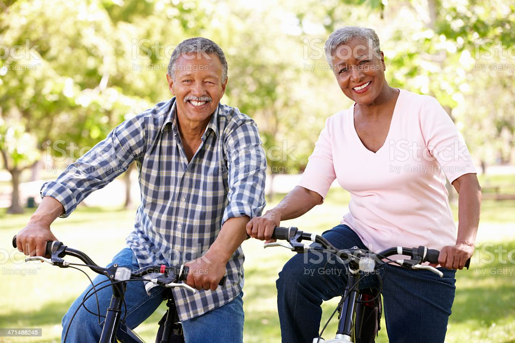 Senior  couple cycling in park royalty-free stock photo