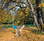 Senior couple dancing at autumn in park