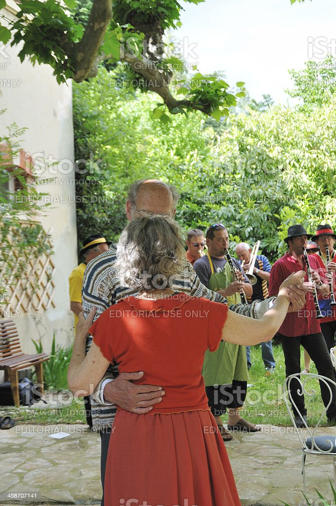 Senior couple dancing at French outdoor village festival stock photo