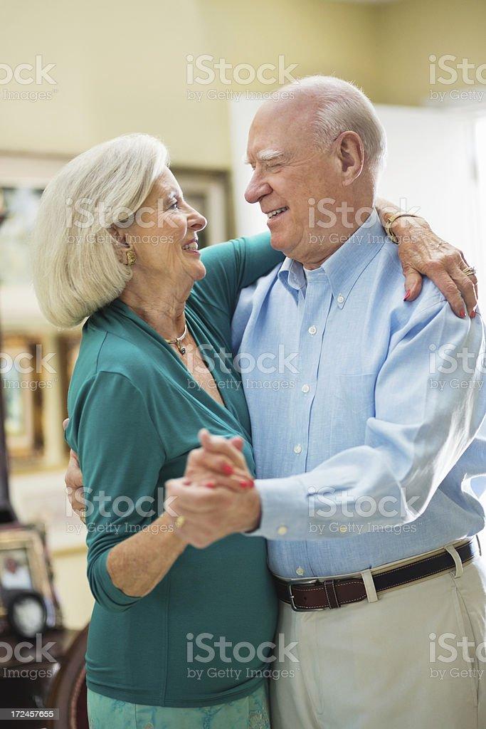 Senior Couple Dancing At Home royalty-free stock photo