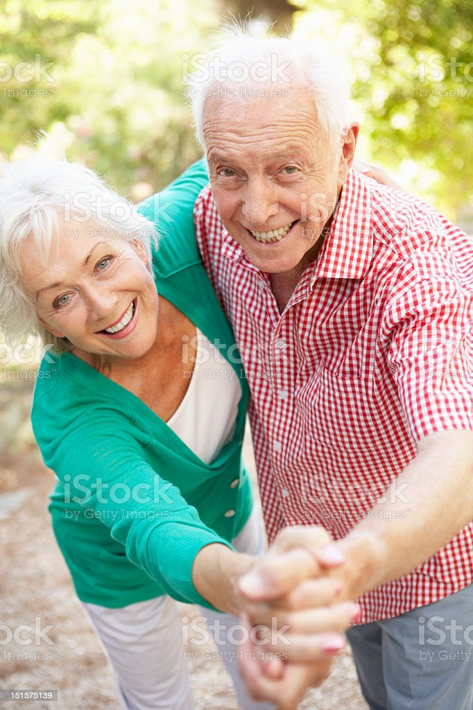 Senior Couple Dancing In Countryside Together stock photo