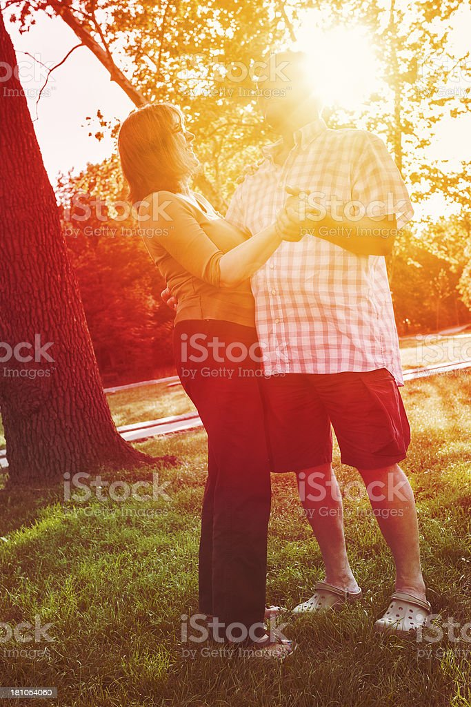 Senior couple dancing in park royalty-free stock photo