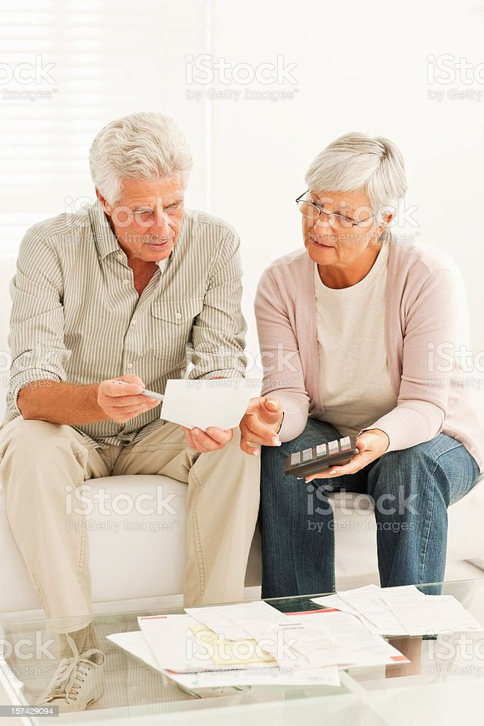 Senior couple discussing the budget royalty-free stock photo