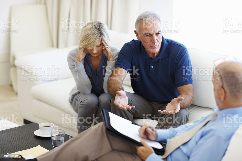 Senior couple discussing their financial issues royalty-free stock photo