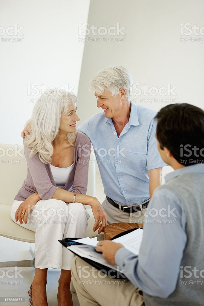 Senior couple discussing with a financial planner royalty-free stock photo