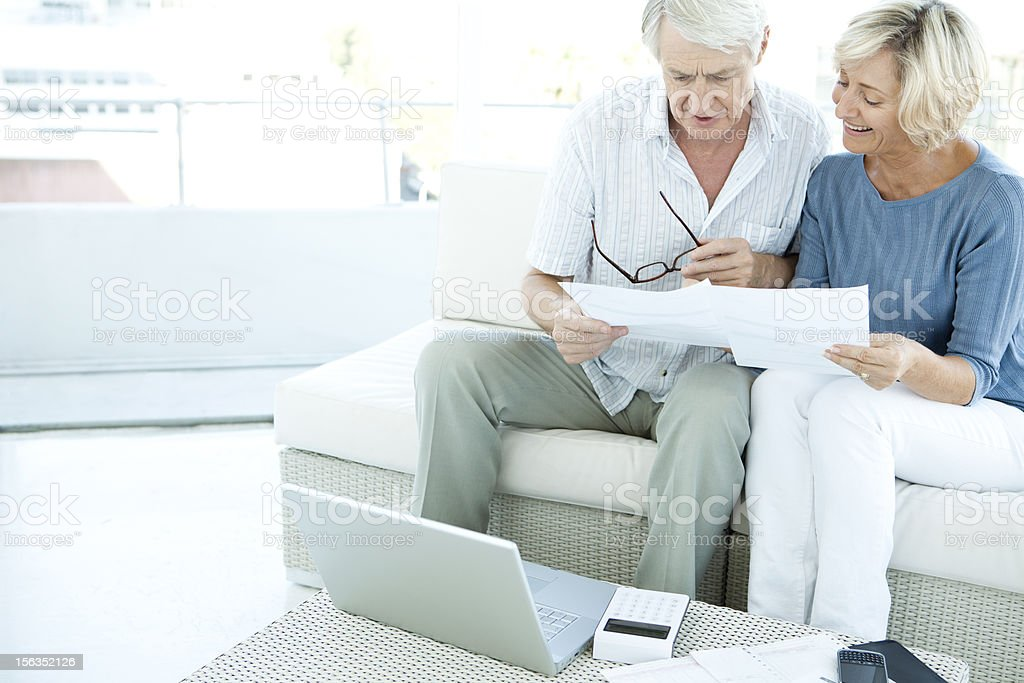 Senior couple doing home finances royalty-free stock photo