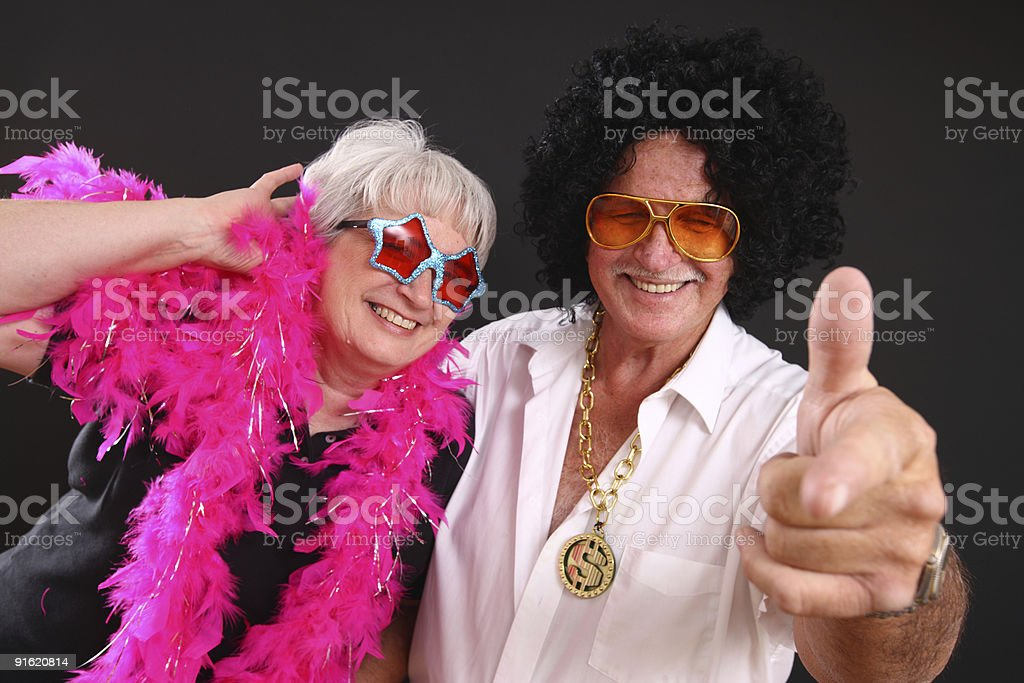 Senior couple dressed up in costumes royalty-free stock photo