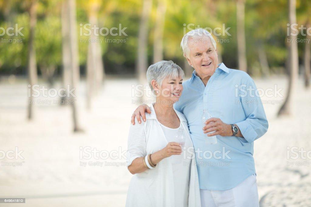 Senior couple drinking water stock photo