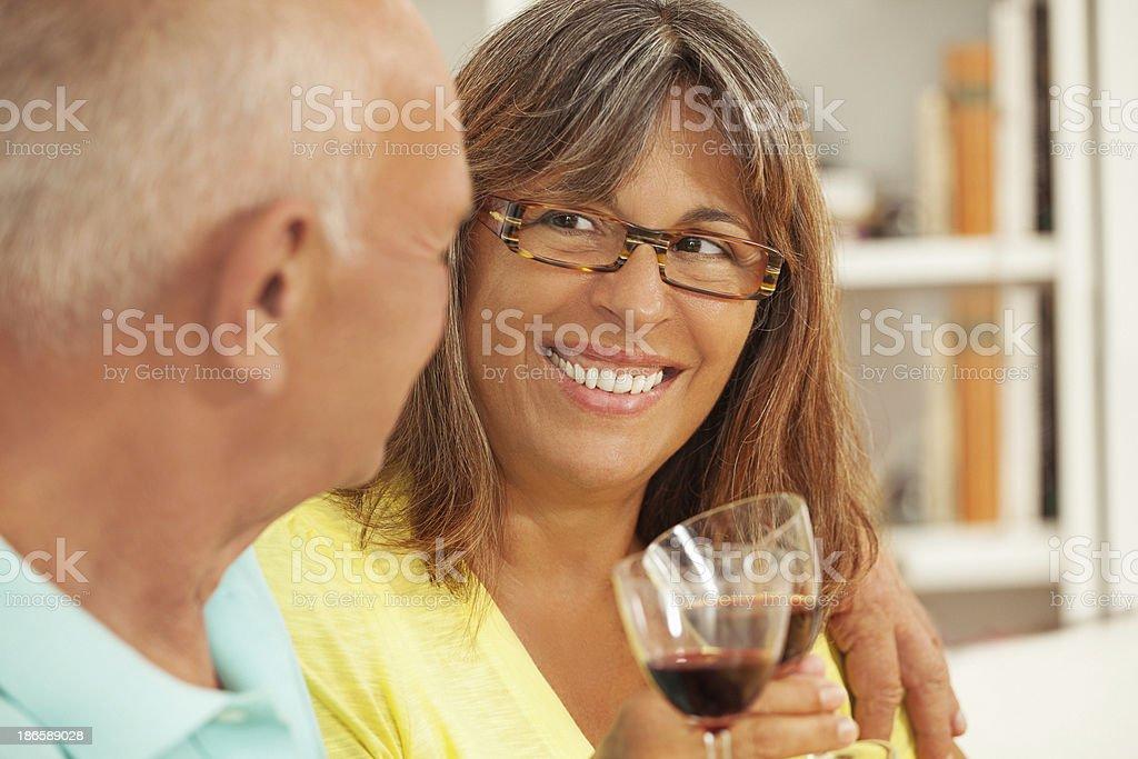 Senior couple drinking wine at home royalty-free stock photo