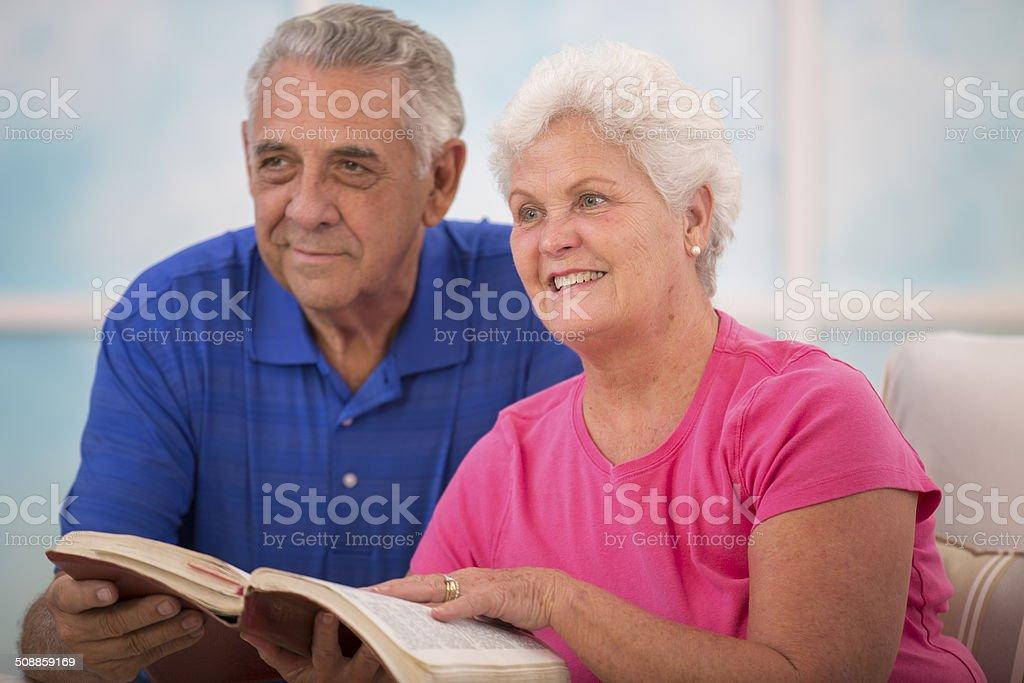 Senior couple during bible study group. stock photo