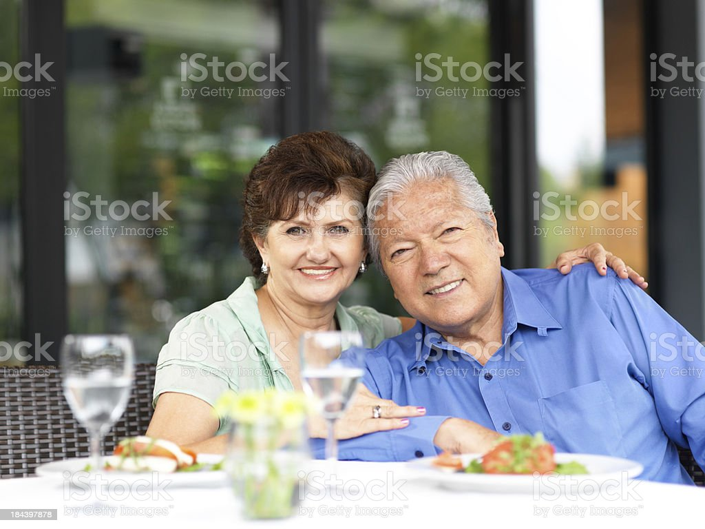 Senior couple eating in a restaurant royalty-free stock photo